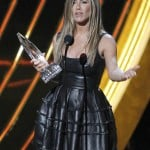 Actress Jennifer Aniston reacts after receiving the
