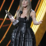 """Actress Jennifer Aniston reacts after receiving the """"Favorite Comedic Movie Actress"""" award at the 2013 People's Choice Awards in Los Angeles"""