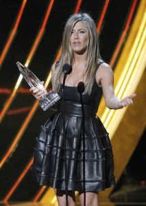 "Actress Jennifer Aniston reacts after receiving the ""Favorite Comedic Movie Actress"" award at the 2013 People's Choice Awards in Los Angeles"