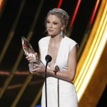 Taylor Swift accepts the award for