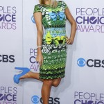 Socialite Paris Hilton poses as she arrives at the 2013 People's Choice Awards in Los Angeles