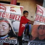 A child supporting Venezuelan President Chavez attends a supporters gathering outside Miraflores Palace in Caracas