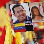 A poster of Venezuelan President Chavez attached with a picture of Jesus Christ, is seen during a rally in Caracas