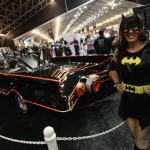 Shelli Mart, dressed in a costume, poses next to the original Batmobile during the Barrett-Jackson collectors car auction in Scottsdale, Arizona