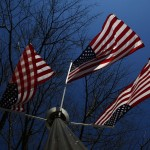 Flags are seen on a pole near the White House in Washington