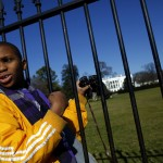 A boy is seen in front of the White House in Washington