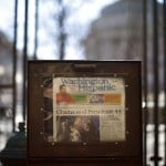A newspaper is seen near the White House in Washington