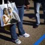 A woman holds a souvenir bag near the White House in Washington