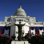 A military band conductor rehearses the Stars and Stripes on the eve of ceremonies marking the second inauguration of U.S. President Obama at the U.S. Capitol in Washington