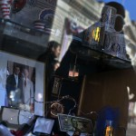 Political souvenirs are seen inside a store window along the U.S. presidential parade route in Washington