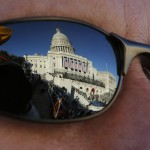 The U.S. Capitol is reflected in a pair of sunglasses in Washington