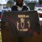 A man holds up a sweatshirt near the White House in Washington D.C.