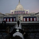 Guests at the Inauguration of the U.S. President Barack Obama take pictures before sunrise at the U.S. Capitol in Washington