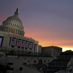 The sun rises over the U.S. Capitol before President Barack Obama's inauguration ceremony in Washington