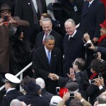 U.S. President Barack Obama is greeted as he arrives for his swearing-in ceremonies on the West front of the U.S Capitol in Washington