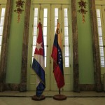 Flags of Cuba and Venezuela are seen at Cuba's foreign ministry during a meeting between the two ministers in Havana