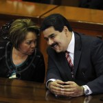 Venezuela's Vice President Nicolas Maduro and the Comptroller General in charge Adelina Gonzalez talk during a ceremony to mark the opening of the judicial year at the Supreme Court of Justice (TSJ) in Caracas