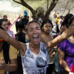 Relatives of inmates protest outside the Centro Occidental prison as an uprising occurs inside at Barquisimeto