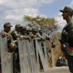 Venezuelan riot guards stand guard outside the Centro Occidental prison in Barquisimeto