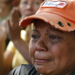 A relative of an inmate cries while protesting outside the Centro Occidental prison as an uprising occurs inside at Barquisimeto