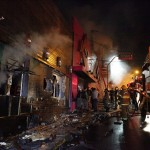 Fire-fighters try to extinguish a fire at Kiss nightclub in the southern city of Santa Maria