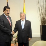 Handout photo showing Chile's President Pinera shaking hands with Venezuela's Vice President Maduro shake during a meeting in Santiago