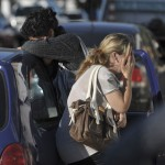 Relatives of the victims of the Kiss nightclub fire cry in the southern city of Santa Maria