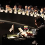 Venezuela's Vice President Maduro reads a letter from President Chavez during a general meeting at the summit of the CELAC in Santiago
