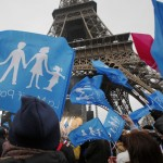 Demonstrators gather on the Champ de Mars near the Eiffel Tower in Paris to protest France's planned legalisation of same-sex marriage.