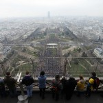 People watch as demonstrators against gay marriage, adoption and procreation assistance gather in the streets of Paris