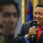 Venezuelan President Hugo Chavez arrives at a news conference after winning elections in Caracas