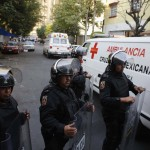 Ambulances pass a police line near the headquarters of state oil giant Pemex in Mexico City