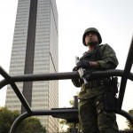 A soldier stands guard near the headquarters of state oil giant Pemex in Mexico City