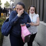 Two women react while leaving the premises of state oil giant Pemex in Mexico City