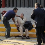An elderly man is being helped outside the headquarters of state oil giant Pemex in Mexico City