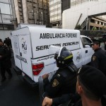 A coroner's vehicle arrives at the headquarters of state-owned oil giant Pemex in Mexico City