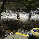A rescue worker sits near debris piled outside the headquarters of state-owned oil giant Pemex in Mexico City