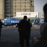 Police helicopters are stationed in the parking lot of state oil giant Pemex in Mexico City