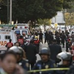 Ambulances and rescue personnel are seen on a street outside the headquarters of state oil giant Pemex in Mexico City