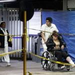 A man wheels an injured Pemex's employee as she leaves Pemex hospital in Azcapotzalco in Mexico City