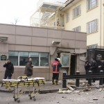 Security officers inspect after an explosion at the entrance of the U.S. Embassy in Ankara
