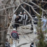 Turkish police forensic experts inspect the site after an explosion at the entrance of the U.S. embassy in Ankara
