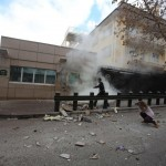 A security officer runs after an explosion at the entrance of the U.S. embassy in Ankara