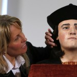 "Philippa Langley, Originator of the ""Looking for Richard"" project, poses for a photograph next to a facial reconstruction of King Richard III at a news conference in central London"