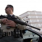LA County Sheriff Deputies with rifles and shotguns keep watch outside of the Twin Towers Jail in response to a unconfirmed sighting by a civilian employee of Christopher Dorner in Los Angeles