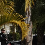 La Palma Police and US Marshals stand outside the home of Christopher Dorner's mother after serving a search warrant  in La Palma