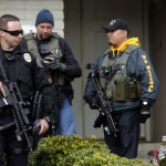 La Palma Police and US Marshals provide security outside the home of Christopher Dorner's mother while investigators work serving a search warrant in La Palma
