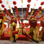 Chinese artists perform the lion dance during the opening ceremony of the Spring Festival Temple Fair in Beijing