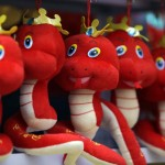 Snake toys are displayed for sale at a temple fair to celebrate the Chinese Lunar New Year  in Beijing