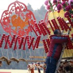 A snake-shaped doll is displayed at a shop during the temple fair in Ditan Park, also known as the Temple of Earth, in Beijing